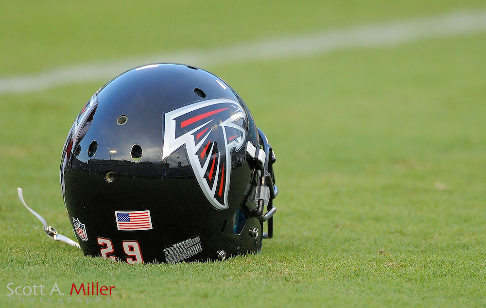 An Atlanta Falcons helmet sits on the field prior to the Falcons game against the Jacksonville Jaguars at EverBank Field on Aug. 19, 2011 in Jacksonville, Fla...©2011 Scott A. Miller
