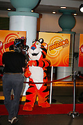 Icon Tony the Tiger hams it up with a videographer at the First Food Network Awards Show live to tape performance held at the Jackie Gleason Theater  of the Performing Arts, in Miami, FL on  Feb 23, 2007.  (Photo/Lance Cheung) <br /> <br /> PHOTO COPYRIGHT 2007 LANCE CHEUNG<br /> This photograph is NOT within the public domain.<br /> This photograph is not to be downloaded, stored, manipulated, printed or distributed with out the written permission from the photographer. <br /> This photograph is protected under domestic and international laws.