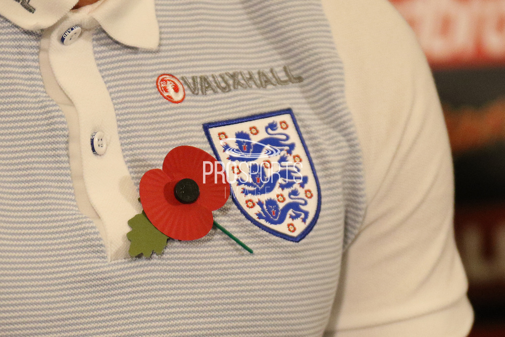 Harry Kane, England striker, wears a poppy on his shirt during the England Team Media Conference ahead of the World Cup qualification match against Scotland, at St George's Park National Football Centre, Burton-Upon-Trent, United Kingdom on 8 November 2016. Photo by Aaron  Lupton.