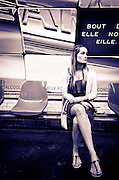 Young woman waiting in a Metro station, Paris, France
