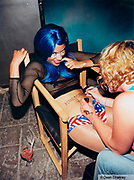 Girl having 'Manumission' painted on her stomach Ibiza 2001