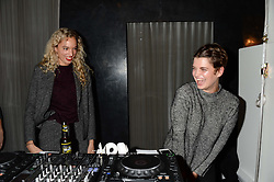 Left to right, PHOEBE COLLINGS-JAMES and PIXIE GELDOF at the opening of the Tiger of Sweden Store, 210 Piccadilly, London on 3rd October 2013.