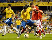 Photo: Ed Godden.<br /> Brazil v Wales. International Friendly. 05/09/2006.<br /> Carl Robinson (R) holds back Brazil's Ronaldinho.