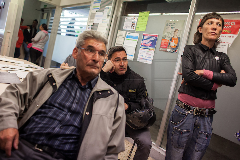 "People in the unemployment office of Nou Barris district waiting to be attended while the office is ocupied by strikers. // Spain's Marchs for Dignity has organized an ocupation of the unemployment offices –INEM- on the eve of May 1st International Worker's Day. With the motto ""bread, work, roof and dignity"", a total of 400 unemployment offices has been occupied by different movements during two hours (11h to 13h) in the Spanish State. 6 millions of people are unemployed in Spain, many of them don't get the public assistance from the adminitration and others receive the minimum amount of 426€ at a month. 30th April."