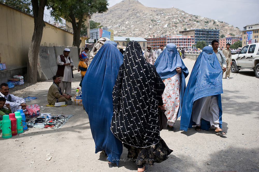 Women in burqa and chador do their shopping in the Kabul Mandawi shopping area of the city. Even more then 10 years after the defeat of the Tabiban regime, the majority of women in Afghanistan still wear the burqa when they venture outside their homes. Kabul, Afghanistan, 2012