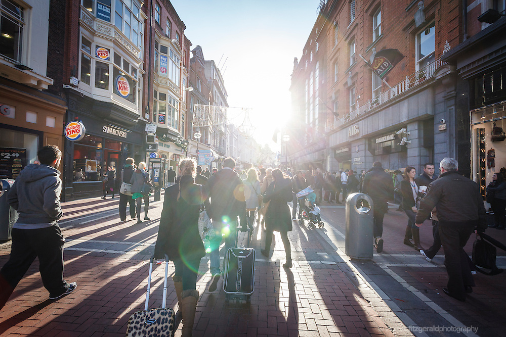 2012: Dublin, Ireland. People in the sun on Grafton Street