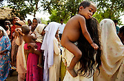 """Lost Daughters: Sex Selection in India"" <br /> <br /> The social perception that females are ""worth"" less than males, and the extremes to which families go to have boys and get rid of girls. Through her images Mary shows us the difficulties that women face in India, even before birth, such as fetal sex selection, government-financed abortion of female fetuses and abandonment after birth. But her work doesn't stop there; she follows women through their life cycle and shows the consequences of this sexist ideology.<br /> <br /> Women are an endangered species in India. 'Raising a daughter,' said an old Punjabi saying, 'is like watering your neighbor's garden.' In the last 20 years India has lost about 10 million girls to sex selection. Due to the devaluation of women and expensive dowries required by the groom's family, women are holding out for boy children. Sons are preferred in India because boys will be more prosperous and take care of their aging parents. They carry on the family name and are the ones to inherit family wealth. Girls are seen as a drain on family resources. Many women rely on illegal ultrasounds to determine sex, leading to the aborting of girl fetuses. The long-term effects are coming to fruition. Despite its status as one of the world's largest democracies, India is a country where women suffer a low status. <br /> <br /> Photo shows: - The daughter of a trafficked woman sits on an older girl's shoulder in a village in Mewat.<br /> ©Mary F. Calvert/Exclusivepix media"