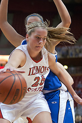 26 February 2006:  Holly Hallstrom drives past Amy Hoffman.....Illinois State Redbirds out muscled the Creighton Bluejays on Senior day by a score of 75-61.  Senior Holly Hallstorm grabbed her 10th double double with 20 points and 12 rebounds.  Competition took place at Redbird Arena on Illinois State University campus in Normal Illinois.
