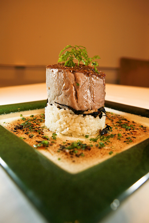 Tuna towering over rice at Corduroy swimming in a Miso sauce in a creative reinterpretation of Japanese cuisine by Chef Tom Power.