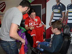 A Bristol Sport shop assistant helps pick out the right size for a young fan - Mandatory byline: Dougie Allward/JMP - 07966386802 - 15/08/2015 - FOOTBALL - Ashton Gate -Bristol,England - Bristol City v Brentford - Sky Bet Championship