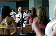 Prospective Denver Broncos cheerleaders look at themselves in a mirror before the finals in cheerleader auditions in Denver, Colorado April 1, 2007.  Over 250 women applied for the 34 slots awarded. REUTERS/Rick Wilking (UNITED STATES)