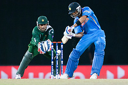 © Licensed to London News Pictures. 30/09/2012. Indian batsmen Virat Kohli batting during the T20 Cricket World super 8's match between India Vs Pakistan at the R Premadasa International Cricket Stadium, Colombo. Photo credit : Asanka Brendon Ratnayake/LNP