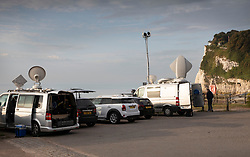 © Licensed to London News Pictures. 04/08/2019. Dover, UK. Television trucks fill the car park as crews and reporters await the arrival of French inventor Franky Zapata at St Margarets as he crosses the English Channel on his jet-powered hoverboard. He is hoping to make the 35km crossing with a refueling stop mid-channel to reach the English coast after setting off at 6am French time. Photo credit: Peter Macdiarmid/LNP