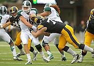 October 6 2013: Michigan State Spartans quarterback Connor Cook (18) tries to push away Iowa Hawkeyes defensive lineman Dominic Alvis (79) during the first quarter of the NCAA football game between the Michigan State Spartans and the Iowa Hawkeyes at Kinnick Stadium in Iowa City, Iowa on October 6, 2013.