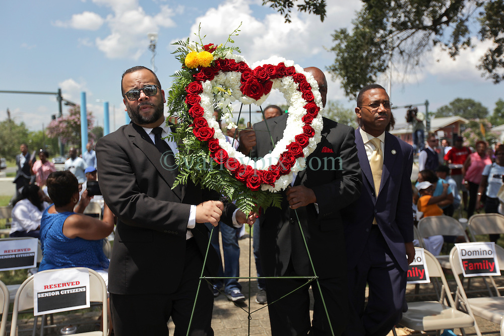29 August 2015. Lower 9th Ward, New Orleans, Louisiana.<br /> Hurricane Katrina 10th anniversary memorials.  <br /> State Senator JP Morrell (l) leads various dignitaries and politicians to the wreath laying ceremony.  <br /> Photo credit©; Charlie Varley/varleypix.com.