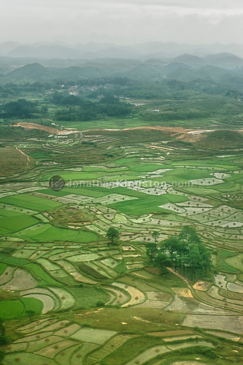 Aerial view of terraced farm land surrounded by mountains near Guilin, China.