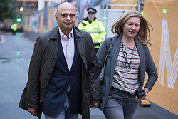 © Licensed to London News Pictures . 30/09/2017. Manchester, UK.  SAJID JAVID with his wife LAURA JAVID outside the secure zone as Manchester prepares for the Conservative Party Conference , which is taking place inside a secured zone around the Manchester Central Convention Centre . Photo credit: Joel Goodman/LNP