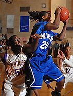 12 JAN. 2010 -- BRENTWOOD, Mo. -- Maplewood / Richmond Heights High School basketball player Tony King (20) hauls in a rebound over Brentwood's Ramond Hunter (50, CQ) during the neighborhood game Tuesday, Jan. 12, 2009 at Brentwood High School in Brentwood, Mo. Photo (c) copyright 2010 by Sid Hastings.