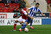 Brighton & Hove Albion central midfielder Beram Kayal (7) and Rotherham United midfielder Tom Adeyemi (24) during the EFL Sky Bet Championship match between Rotherham United and Brighton and Hove Albion at the AESSEAL New York Stadium, Rotherham, England on 7 March 2017.