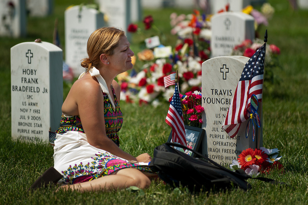 LAURA YOUNGBLOOD weeps over the grave of her husband Travis L. Youngblood at section 60 in Arlington National Cemetery on Memorial Day.