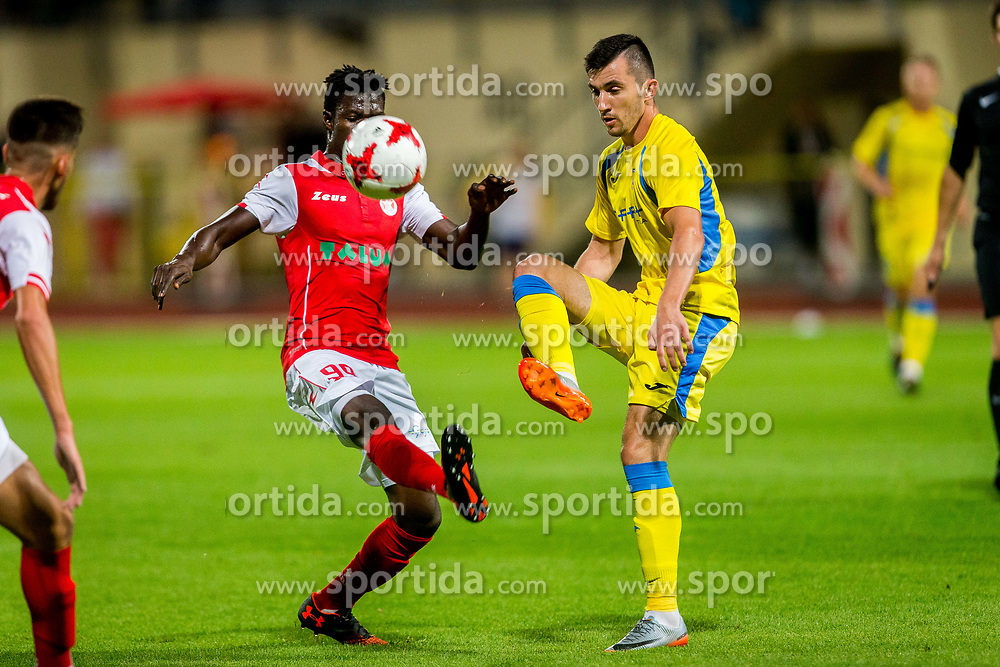 Alen Ozbolt of NK Domzale and Derrick Ediyaa Mensah of NK Aluminij during football match between NK Domžale and NK Aluminij in 6th Round of Prva liga Telekom Slovenije 2017/18, on August 20, 2017 in Sports park Domzale, Domzale. Photo by Ziga Zupan / Sportida