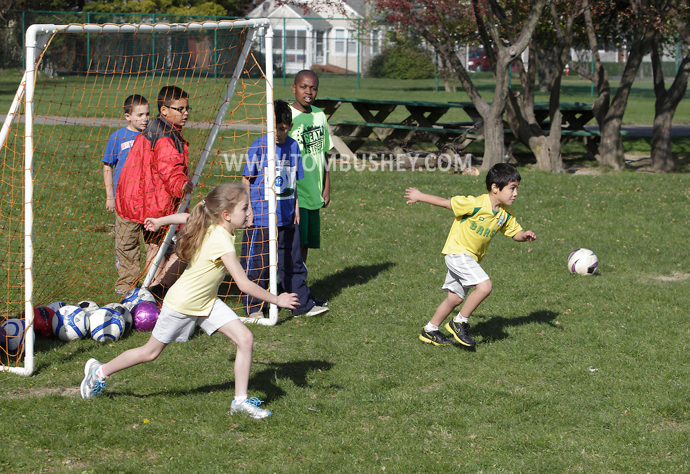 Middletown, New York  - Children practice soccer during a program at the Middletown YMCA on April 14, 2012.