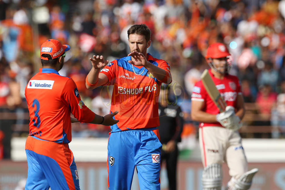 Andrew Tye of the Gujarat Lions and Gujarat Lions captain Suresh Raina celebrates the wicket of Marcus Stoinis of Kings XI Punjab during match 26 of the Vivo 2017 Indian Premier League between the Gujarat Lions and the Kings XI Punjab held at the Saurashtra Cricket Association Stadium in Rajkot, India on the 23rd April 2017<br /> <br /> Photo by Vipin Pawar - Sportzpics - IPL