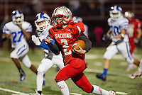 Laconia's Kyle Chiasson charges down field to score during Friday night's Homecoming game against Manchester West.  (Karen Bobotas/for the Laconia Daily Sun)