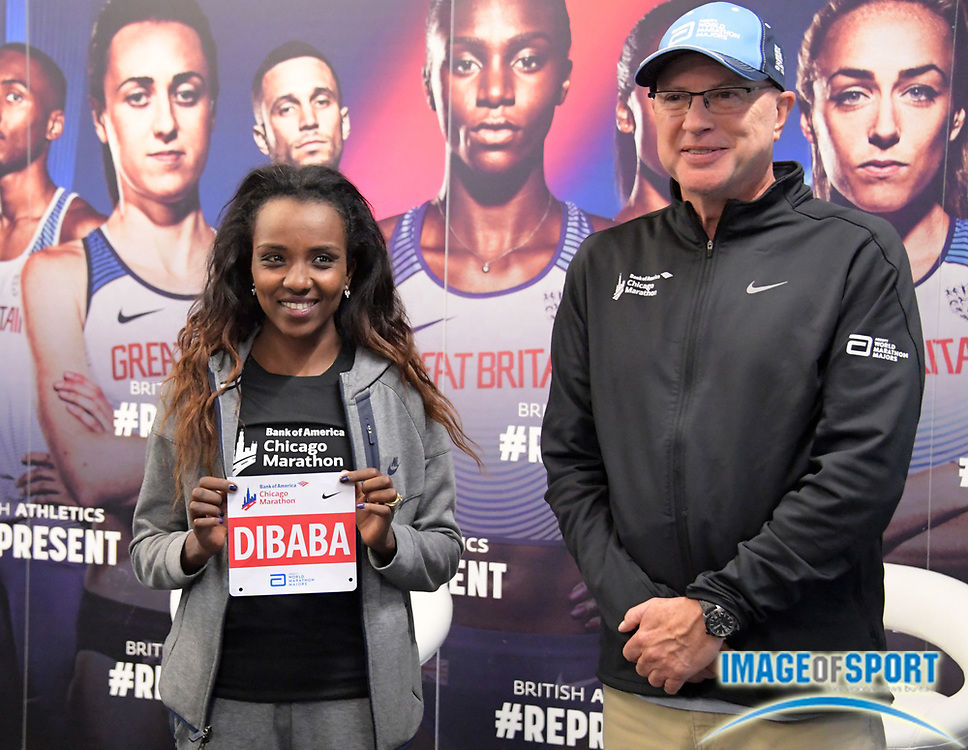 Aug 7, 2017; London, United Kingdom; Tirunesh Dibaba (ETH), left, poses with Chicago Marathon race director Carey Pinkowski at a press conference to announce her participation in the 2017 Chicago Marathon at Tobacco Dock.