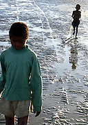 Children on the mud bay facing the Indian Ocean in Tuléar (Toliara), Madagascar
