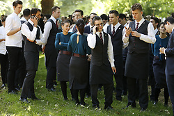 © Licensed to London News Pictures. 06/06/2018. London, UK. Staff from the evacuated Mandarin Oriental hotel stand in Hyde Park. Fifteen fire engines and 97 firefighters and officers have been called to a fire believed to be at the Mandarin Hotel in Kightsbridge. Photo credit: Peter Macdiarmid/LNP