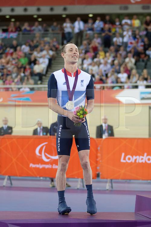 © London News Pictures. 31/08/2012. Stratford, London, UK. Shaun McKeown GBR - men's individual C3 pursuit silver medal winner. Photo credit should read Manu Palomeque/LNP