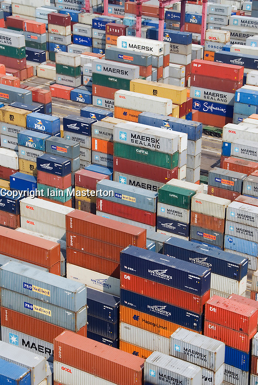 Many shipping containers stacked on quay at Container Terminal in Hong Kong port
