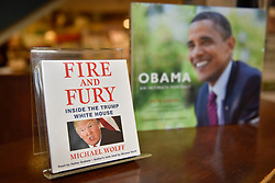 "© Licensed to London News Pictures. 07/01/2018. CHICAGO, USA.  An audiobook of the new book ""Fire and Fury, Inside the Trump White House"", by Michael Wolff is on display in Barnes & Noble bookshop in downtown Chicago.  Barnes & Noble have already received advanced orders ahead of the official on sale date of 9 January, but some other booksellers have obtained advance copies which have sold immediately sold out.  A copy of a book ""Obama, an intimate portrait"", by official President Obama White House photographer, Pete Souza, is seen behind.  Photo credit: Stephen Chung/LNP"