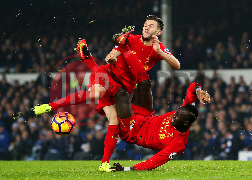 Sadio Mane of Liverpool tangles with team mate Adam Lallana - Mandatory by-line: Matt McNulty/JMP - 19/12/2016 - FOOTBALL - Goodison Park - Liverpool, England - Everton v Liverpool - Premier League