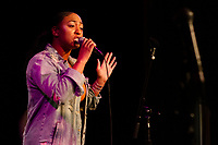 """The Promontory, located at 5311 S. Lake Park West hosted Boogie Nights Monday evening, March 25th, 2019. This ongoing event gives up and coming artists the opportunity to perform and show what they can do.<br /> <br /> 8285 – Soul singer, Shatoria Rose performed<br /> <br /> Please 'Like' """"Spencer Bibbs Photography"""" on Facebook.<br /> <br /> Please leave a review for Spencer Bibbs Photography on Yelp.<br /> <br /> Please check me out on Twitter under Spencer Bibbs Photography.<br /> <br /> All rights to this photo are owned by Spencer Bibbs of Spencer Bibbs Photography and may only be used in any way shape or form, whole or in part with written permission by the owner of the photo, Spencer Bibbs.<br /> <br /> For all of your photography needs, please contact Spencer Bibbs at 773-895-4744. I can also be reached in the following ways:<br /> <br /> Website – www.spbdigitalconcepts.photoshelter.com<br /> <br /> Text - Text """"Spencer Bibbs"""" to 72727<br /> <br /> Email – spencerbibbsphotography@yahoo.com<br /> <br /> #SpencerBibbsPhotography <br /> #HydePark <br /> #Community <br /> #Neighborhood<br /> #CanonUSA"""