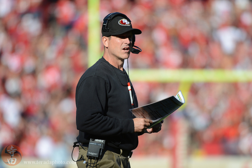 December 1, 2013; San Francisco, CA, USA; San Francisco 49ers head coach Jim Harbaugh looks on against the St. Louis Rams during the second quarter at Candlestick Park.