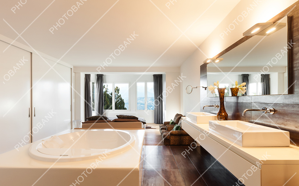 beautiful interiors of a modern house, bedroom view from bath