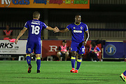 AFC Wimbledon striker Dominic Poleon (10) scores a goal 3-0 and is congratulated by AFC Wimbledon midfielder Dean Parrett (18) during the EFL Trophy match between AFC Wimbledon and U23 Swansea City at the Cherry Red Records Stadium, Kingston, England on 30 August 2016. Photo by Stuart Butcher.
