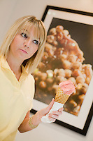 24 October, 2008. New York, NY. Sales and marketing associate of Pierre Marcolini Chocolatier, Tracey Cowie, 22, scoops a fragola (strawberry) gelato into a cone at the Pierre Marcolini Chocolatier shop in Manhattan, NY.<br /> The gelato free-standing case is new feature of the shop.<br /> NOTE: The gelato displayed here is produced by Taste Gelato Artigianale, and not by Pierre Marcolini Chocolatier.<br /> NOTE: Since no customers were at the shop, the subject posed for the photographer.<br /> <br /> ©2008 Gianni Cipriano for The New York Times<br /> cell. +1 646 465 2168 (USA)<br /> cell. +1 328 567 7923 (Italy)<br /> gianni@giannicipriano.com<br /> www.giannicipriano.com