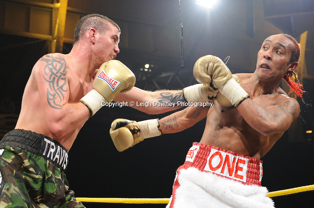 Travis Dickenson (camouflage shorts) defeats Llewellyn Davies (quarter finals) at Prizefighter The Light Heavyweights II, Olympia, London on 29th January 2011. Photo credit © Leigh Dawney.