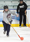 """Balls to the Wall"" teammates Andrea Yutzy (lef) and Karen Buddie (right) and  play during an intramural broomball game on Wednesday, 11/1/06. Their team won the championship for the women's league in 2006, their third year in a row as champs."