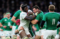 Maro Itoje of England takes on the Ireland defence - Mandatory byline: Patrick Khachfe/JMP - 07966 386802 - 27/02/2016 - RUGBY UNION - Twickenham Stadium - London, England - England v Ireland - RBS Six Nations.