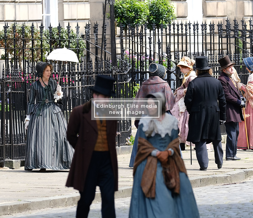 "Moray Place in Edinburgh's Georgian old town was turned into 19th century London for Julian Fellowes' new ITV show ""Belgravia"".<br /> <br /> Pictured: Tamsin Greig (striped dress) during a take<br /> <br /> Alex Todd 