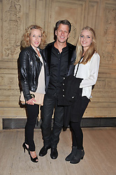 ANDREW CASTLE and his wife SOPHIA with their daughter CLAUDIA at Cirque du Soleil's VIP night of Kooza held at the Royal Albert Hall, London on 8th January 2013.