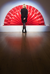 "Bonhams, Mayfair, London. A woman admires an Untitled ""red fan"" sculpture estmated at £1.5 - 2 million by Kazuo Shiraga to be auctioned at Bonhams post-war and Contemporary art sale.  //FOR LICENCING CONTACT: paul@pauldaveycreative.co.uk TEL:+44 (0) 7966 016 296 or +44 (0) 20 8969 6875. ©2015 Paul R Davey. All rights reserved."