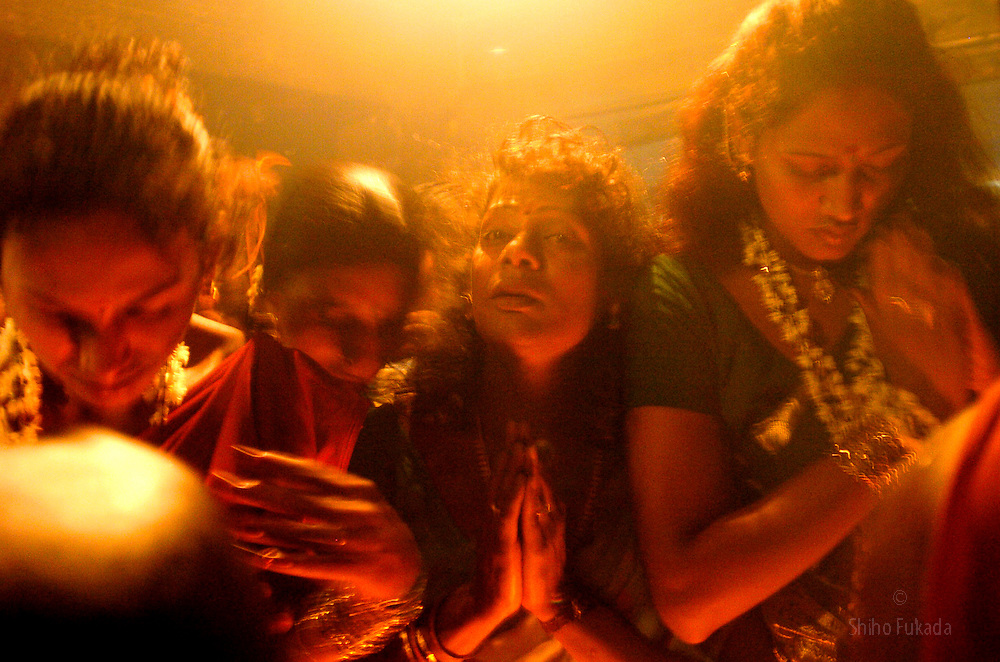 Transgenders pray during &quot;Kuthandavar -aravan festival&quot; in the town of Koovagam in India. <br />