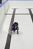 Middletown, New York - A worker paints the empty pool at the Middletown YMCA on Tuesday, Aug. 28, 2012. The pool is briefly closed each year for maintenance.