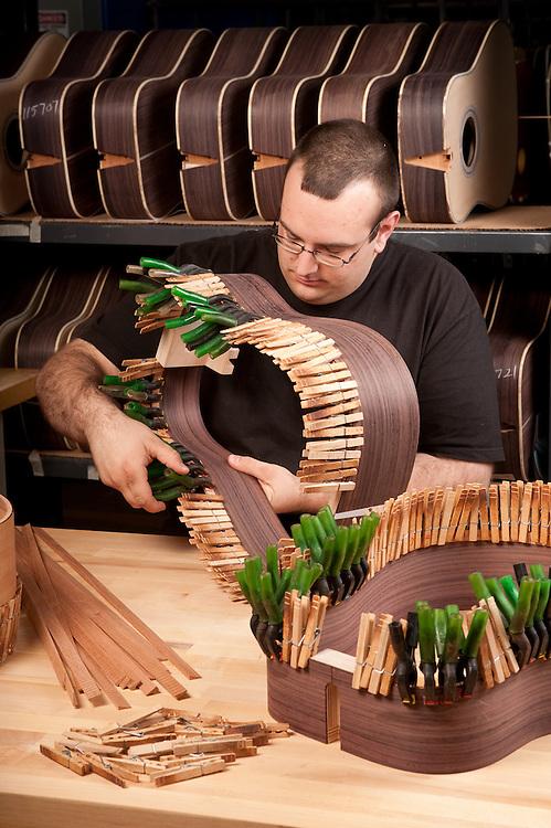 Man working on a handmade guitar