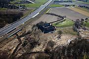 Nederland, Limburg, Gemeente Roermond, 07-03-2010; Swalmen, begin van de landtunnel Swalmen in de A73-Zuid, gebouwd om overlast voor de omgeving tegen te gaan. De snelweg en spoorlijn gaan over het riviertje de Swalm. Rechtsonder het dal van de Swalm, natuurgebied, met versterkte boerderij (hoeve).Beginning of landtunnel Swalmen motorway A73 south, built to counter environmental inconvenience. The highway and railroad cross the river Swalm. Below right the valley of the Swalm with fortified farm.luchtfoto (toeslag), aerial photo (additional fee required).foto/photo Siebe Swart